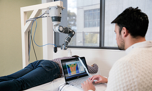 A collaborative robot targeting laser therapy on the patient